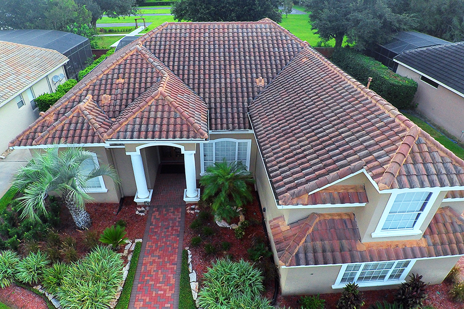 Aerial drone photo of the roof and front of a house.